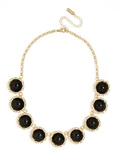 Rounded ebony gems encircled in pavé crystals are a super sleek statement maker, and a perfectly polished addition to an evening ensemble.