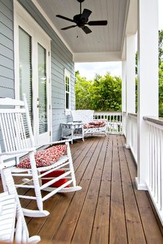 Love front porches especially when they have a porch swing :)