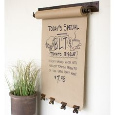 This hanging message roll, featuring an antiqued brass back plate, is perfect for your farmhouse kitchen for keeping grocery or to-do lists handy and includes four clips for displaying special notes or family photos.