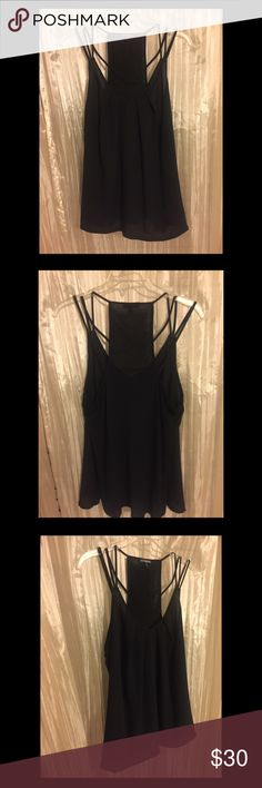 🔥Express Black Strappy Top. LG. NWOT. Lovely! 🔥 Fun black 3 strap top! Can be dressy or casual. Super cute and in perfect condition. 💫 An almost racerback. Flirty and fun! Not snug but not baggy. Perfect fit. Express Tops