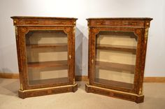 A fine pair of Victorian Period burr walnut & marquetry inlaid antique pier cabinets by Edwards & Roberts Of London.