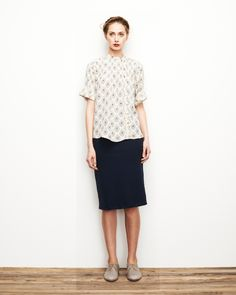 Short sleeve print blouse (buttoned up, untucked), navy pencil skirt, light brown oxfords