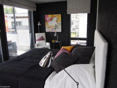 Black texture wall in the bedroom with colourful and crome details against it, love it! At Villa Beauty in Vantaan asuntomessut