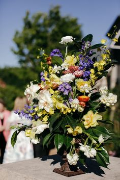 Colourful floral centrepiece arrangement by Lola Mai Floral Styling // Photos by Lara Hotz Photography