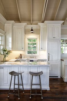 Ceiling with different color (darker than kitchen) & large hardware on doors. Love this kitchen .