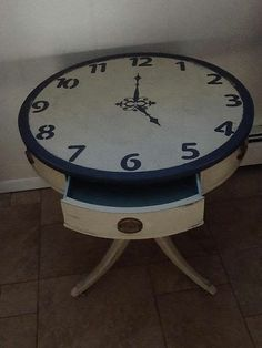 Antique drum table with clock face painted Annie Sloan country grey, graphite and duck egg blue in drawer.
