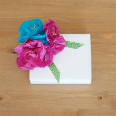 Make little tissue paper flowers to decorate gifts, wedding favors... anything you can think of!