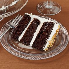 Dark Chocolate Carrot Cake Recipe -Carrot cake has a dark side—and it's divine! Cream cheese and shredded carrots in the batter keep the cake moist, while toasted nuts and cinnamon boost the flavor. —Darlene Brenden, Salem, Oregon