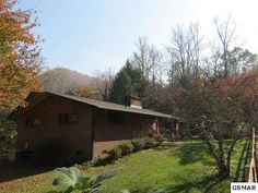 One level updated ranch ... home in coveted Mynatt Park. An awesome opportunity to live near the National Park. Stunning location with the ease of getting in and out of Gatlinburg. Wiring and plumbing has been upgraded. You have a 1 car carport with a small workshop attached and driveway for ample parking. Home is lovely, has a completely fenced in yard. Enter into formal dining area with wood burning FP, to left is a office, a beautiful hall bath, a good sized BR and a master suite. The…