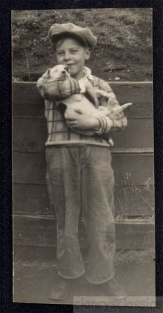 Young boy and puppy, 1924. Adorable.