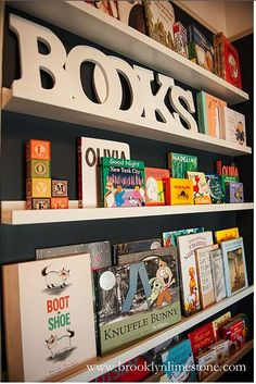 playroom bookcase - using Ikea Ribba picture ledge $9-$14.