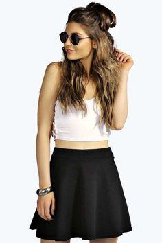 $8, Black Skater Skirt: Boohoo Kasey Ribbed Full Circle Skater Skirt. Sold by BooHoo. Click for more info: https://lookastic.com/women/shop_items/293136/redirect