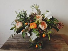 kumquats, peach english roses, dusty miller, brunia