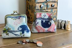 Coin purse made with super cute sloth themed Cotton & Steel print outer, navy cotton interior and a hand stitched metal frame