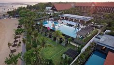 From above.  Fantastic aerial photo of Fairmont Sanur Beach Bali, with our beach, main pool, Nyala restaurant, lobby and suites visible. Our poolside Nyala restaurant could accommodate a party of up to 200 people. The restaurant has a formal upscale ambiance to complement the perfect evening.