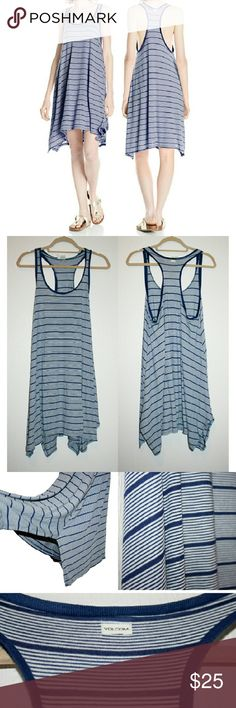 Volcom Stripe Racerback Tank Dress NWT I love this relaxed, flowy tank dress! The navy and white stripes give a casual nautical vibe. It features a scoop neck, sharkbite hemline, and racerback. The armholes are pretty deep, so it's a dress I would wear a cami slip or cute bralette under, but it's not totally necessary. The fabric is 54% polyester and 46% viscose - super comfy! Volcom Dresses Midi