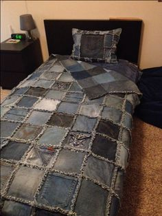 "Double sided Denim Rag Quilt and Denim Pillow made from old recycled blue jeans - Class Auction item. Cut 8x8"" blocks with 8 columns down and 12 rows across. Used a 1/2 inch seam for the fringe. It fits a twin size bed."