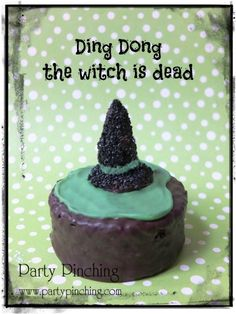 Ding Dong the witch is dead! Hostess Ding Dong with green icing and a little witch's hat made from a candy corn dipped in chocolate and then rolled in black sprinkles - it is set on top of a black candy melt with black sprinkles.