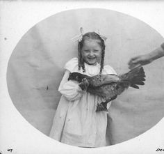 Miriam holding a chicken, Fort Lawton, December 1899 :: H. Ambrose Kiehl Photograph Collection