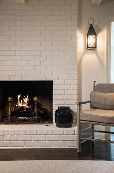 another direction for lighting. fireplace, painted brick, wall sconce © Jay Adkins for Sean Anderson Design Fireplace Wall, Fireplace Design, Fireplace Remodel, Formal Living Rooms, Living Room Decor, Dining Room, Exposed Brick Fireplaces, Painted Brick Walls, Dark House