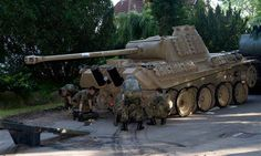 WWII Tank Was Stashed in 78-Year-Old's Cellar ( Now THAT'S a Serious Collector.. )  http://www.newser.com/story/209357/wwii-tank-was-stashed-in-78-year-olds-cellar.html