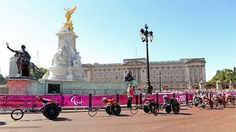 Athletes pass Big Ben as they compete in the men's T54 marathon