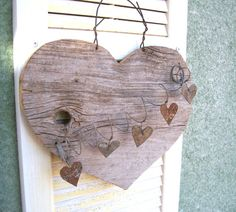Cute old wood heart with rusty metal hearts