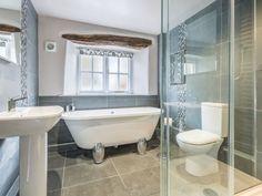 This is the dream luxury bathroom! Featuring a free standing bath, slate tiling, a walk in shower and chunky oak beams! Shower Over Bath, Steam Showers Bathroom, Walk In Shower, Standing Shower, Bath Tiles, Bath Tub, Roll Top Bath, Modern Bathroom, Loft Bathroom