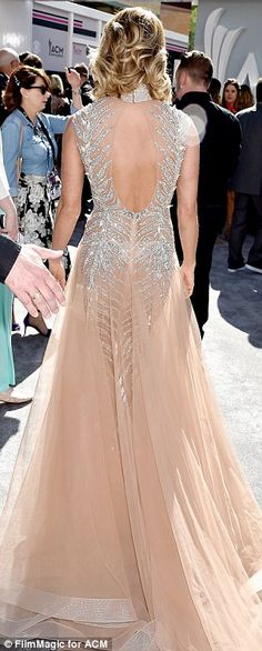 Attention to detail: Underwood's backless gown cinched in at her narrow waistline...