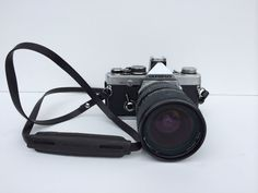Olympus OM  2N with Tokina 28-70 2.8 lens by twoartistoneshop
