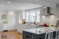 timeless white kitchen design - open white kitchen with window above the sink