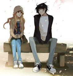 Black haired guy and girl with long blonde hair... Both look awkward.