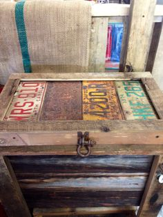 Rustic cooler top with old tags.