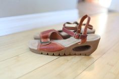 AMAZING vintage 70s wedge sandals by Yo-Yos! Hard to find larger size.  - adjustable ankle straps - buckle at toes - rubber wedge heel - cut out wedge heel - leather uppers  Condition: very good vintage condition, some dirt on soles. Very slight cigarette odor (I dont smoke, but previous owner probably did).   Label: Yo-Yos by Fanfare  Size: US womens size 10 M (runs true to size, I wear a 9 and these are too big for me)  Leather uppers, all other parts man made  Circa: 1970s   Insole…