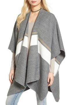 Soft neutral hues make this striped poncho perfect for layering over practically anything.