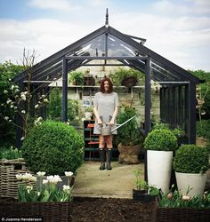 Daily Mail's Clare Nolan in her Swallow Raven Greenhouse from http://www.greenhousestores.co.uk painted in Midnight. #greenhouses #swallowgreenhouses #growyourown http://www.greenhousestores.co.uk