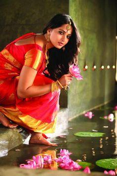 South Indian bride. Temple jewelry. Jhumkis.Red silk kanchipuram sari.Braid with fresh jasmine flowers. Tamil bride. Telugu bride. Kannada bride. Hindu bride. Malayalee bride.Kerala bride.South Indian wedding.Anushka Shetty