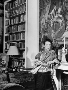 Madam Elsa Schiaparelli Enjoying Her Study Which is Filled with Treasures, Paintings, and Books Premium Photographic Print