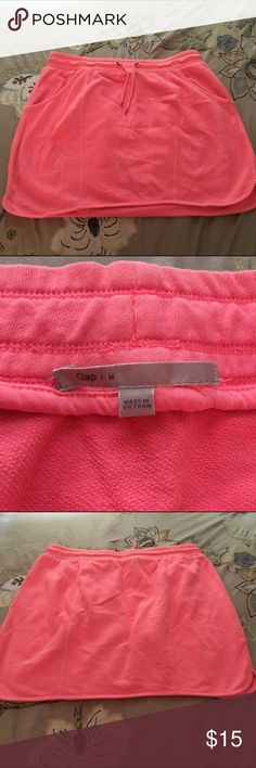 GAP Body Coral Mini Skirt Awesome bright coral tennis skirt! Perfect to throw on over your bikini bottoms. Nice quality, thicker material but very soft and stretchy. Excellent quality and condition. Check out my other listings to bundle and save 25% 😎! GAP Skirts Mini