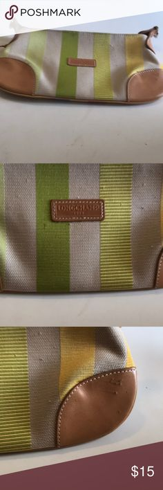 Long champ pouch Stripped canvas & leather bag. Zip closure. Creed labels inside. Scratches & snags on one side of exterior. Strap is missing. Tiny stains inside. Very useable & convenient Longchamp Bags Mini Bags