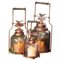 A lovely addition to your three-season porch or den, these metal candleholders in antique copper showcase charming bird finials and textured glass cloches. Patio Lanterns, Lanterns Decor, Candle Lanterns, Large Candles, Pillar Candles, Angle Pictures, Three Season Porch, Lantern Set, Kitchen Dinning
