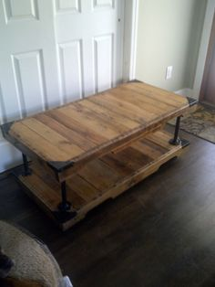 Pallet wood and recycled plumbing pipe coffee table