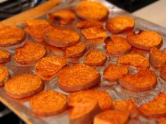 Approx. 230 calories for entire dish.  Ingredients: 2 Sweet Potatoes, Olive oil spray, Cinnamon, sea salt Instructions:  Preheat oven to 450f.  Place parchment paper on cookie sheet. .  Cut sweet potatoes into thin circles.  Place sliced potatoes on cookie sheet. Try not to have them overlap.  Spray olive oil over sweet potatoes.  Sprinkle cinnamon & sea salt on top.  Bake for 25ish min or until fork easily enters the sweet potatoes.