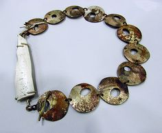 Roxy Lentz Necklace: Untitled 2013 Re-purposed silver plated tray, PVC found in street