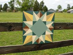 Silver Threads and Golden Needles, original quilt block from The Block Book by Judy Martin, 1998. Barn Quilt On the Fence