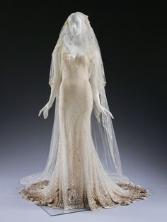 Kate Moss's wedding dress and veil designed by John Galliano, for her wedding to Jamie Hince in 2011 (c)Victoria and Albert Museum, London