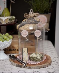 love this idea ... use a glass dome on a wood base/cutting board and decorate the top of the dome with burlap ribbon.