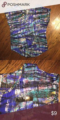 Super cute multicolor blouse Size M. Has open key hole shoulders. Longer in the back. Super super cute! Tops Blouses