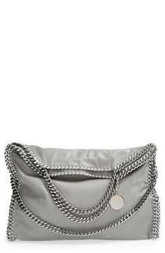 Free shipping and returns on Stella McCartney 'Falabella' Shaggy Deer Foldover Tote at Nordstrom.com. A shimmer-struck tote ups the ante with street-chic styling, trimmed in silver-link chains that drape against the slouchy, fold-over silhouette. Carry on your arm with the shorter straps or use the fold-over chain for a shoulder style.