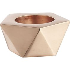 Everything's coming up rosy.  Geo form beams a rosy glow, handcrafted of brass with coppery rose gold finish.  Hosts a single tealight (not included).  Details…